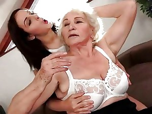 Adorable dark haired enjoys big-boobed granny