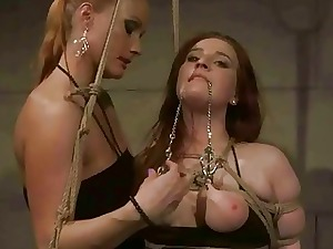 Spiffy dominatrix punitive chesty redhead