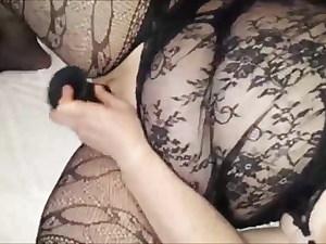Mature in fishnets masturbates with her dildo