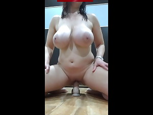 Huge-chested woman playing with her dildo