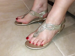 Classy gold thong sandals and sexy soles